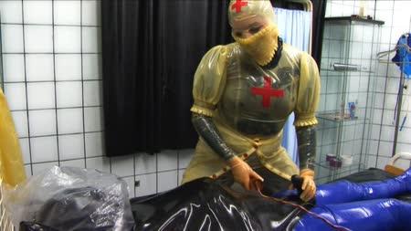 Slut in rubber zips herself in rubber sack 4